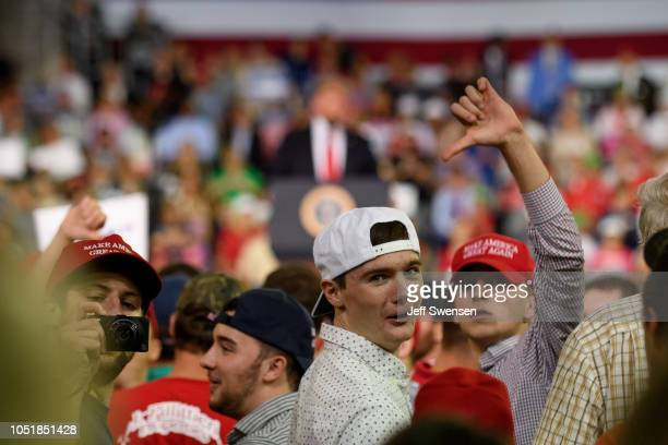 Audience members respond to US President Donald Trump's call to express disapproval at the media at a rally at the Erie Insurance Arena on October 10...
