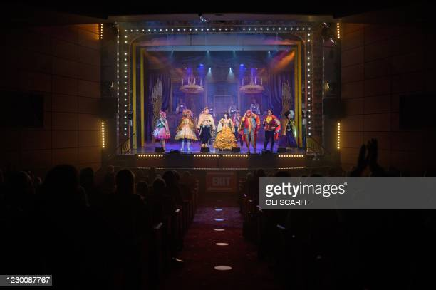 Audience members, sat in socially-distanced groups, watch the Christmas pantomime 'Beauty and the Beast' at St Helens Theatre Royal, in St Helens,...