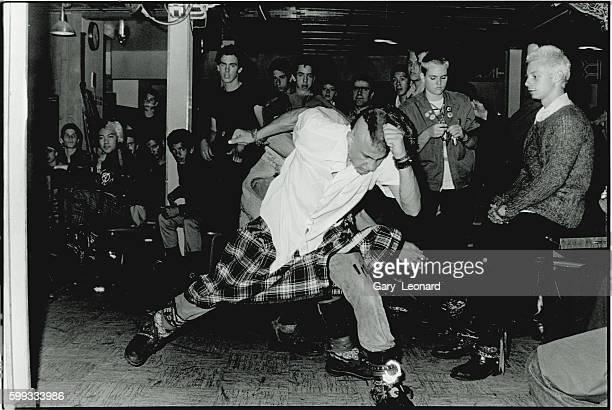 Audience members slam dancing at a punk music show in the Hong Kong Cafe in LA's Chinatown