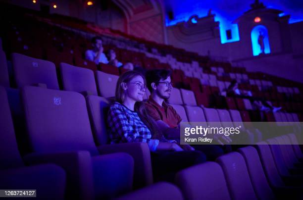 Audience members the last screening in the Grand Salle, the largest auditorium in Europe, at the Grand Rex cinema before it closes its doors until...