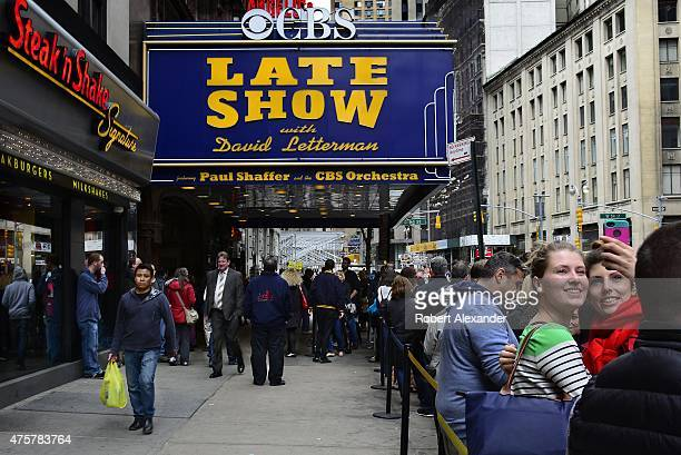 Audience members wait in line before entering the Ed Sullivan Theater in New York to see a taping of the CBS late night television program 'Late Show...