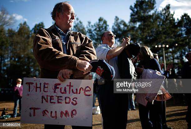 Audience members wait to hear Republican presidential candidate Donald Trump deliver remarks on February 17 2016 in Walterboro South Carolina Trump...