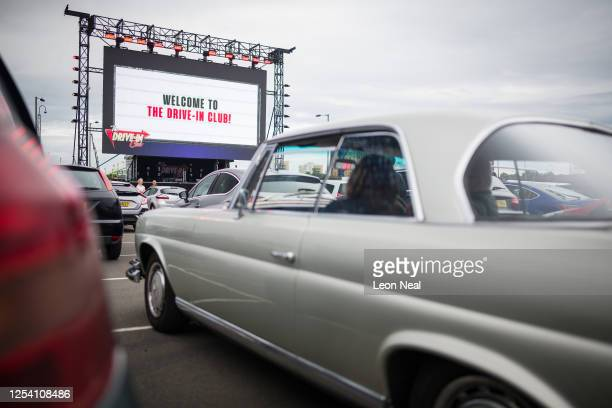 Audience members wait to watch a live comedy performance by Dom Joly at the Drive-In Club venue on July 03, 2020 in London, England. Providing food...