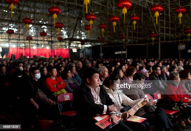 Audience members watch a performance at the West Kowloon Bamboo Theatre a 800seat temporary theatre to house a series of Cantonese opera shows in...