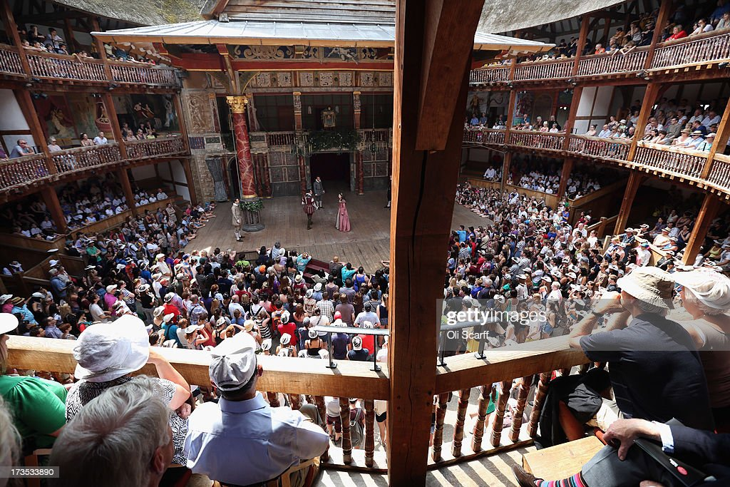 Theatregoers Enjoy The Sunshine During A Performance At The Globe : News Photo