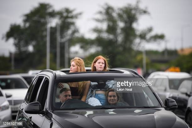 Audience members watch a slide presentation during a live comedy performance by Dom Joly at the Drive-In Club venue on July 03, 2020 in London,...