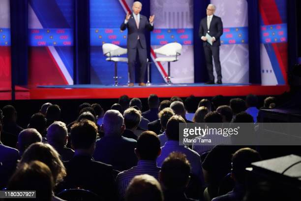 Audience members watch as Democratic US presidential candidate and former Vice President Joe Biden speaks as CNN moderator Anderson Cooper looks on...