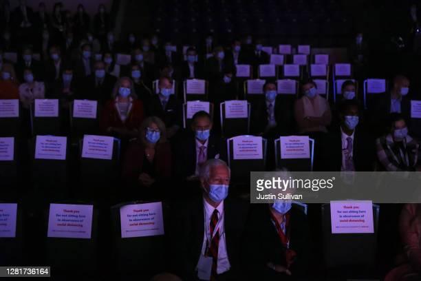Audience members watch the final presidential debate with U.S. President Donald Trump and Democratic presidential nominee Joe Biden at Belmont...