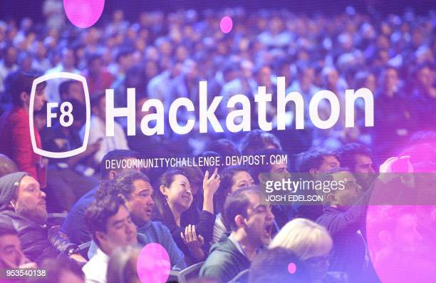 Audience members watch the stage as a Hackathon graphic appears on a screen during the annual F8 summit at the San Jose McEnery Convention Center in...
