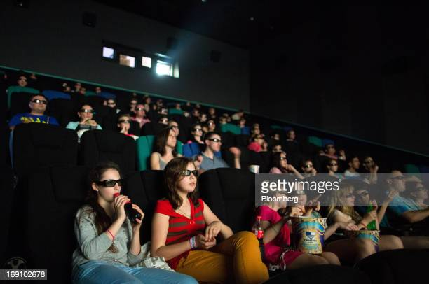 Audience members wear 3D spectacles to watch a movie inside a Cinema Park multiscreen theatre complex at the Metropolis Shopping and Entertainment...