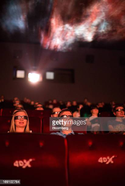 Audience members wear 3D spectacles to watch a movie using 4DX motion picture technology at the Cinema Park multiscreen theatre complex at the...