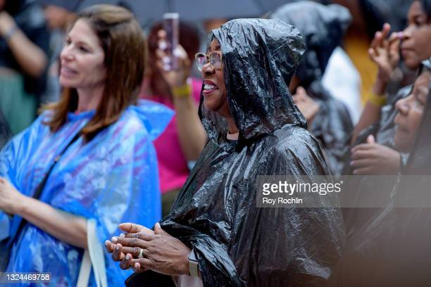 """Audience members wear plastic bags to protect them from the rain as Gladys Knight performs during Questlove's """"Summer Of Soul"""" screening & live..."""