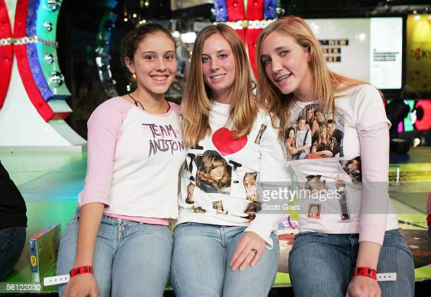 Audience members wearing homemade Jennifer Aniston tshirts pose for a photo during MTV's Total Request Live at the MTV Times Square Studios on...