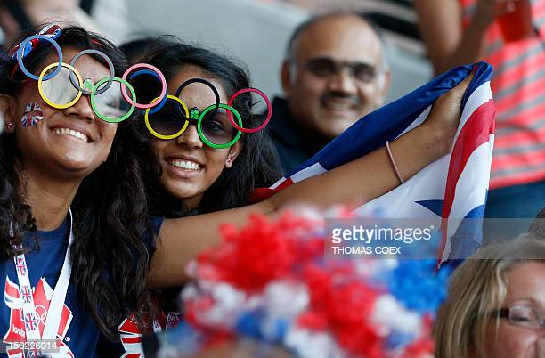 Audience members wearing Olympic ring glasses react inside the Olympic stadium during the closing ceremony of the 2012 London Olympic Games in London...