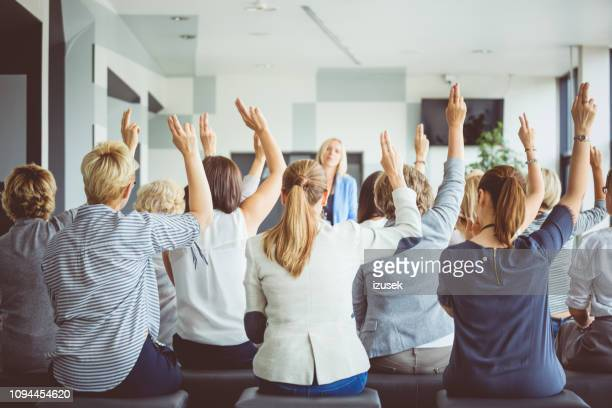 audience voting during seminar - democracy stock pictures, royalty-free photos & images