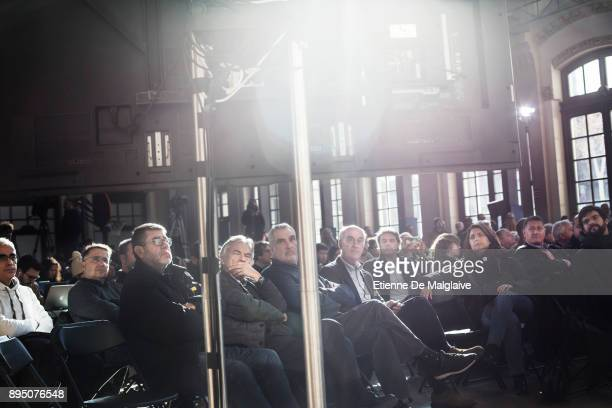 Audience watch on a live video feed from Brussels deposed Catalan President Charles Puigdemont delivering a short speech during campaign meeting of...