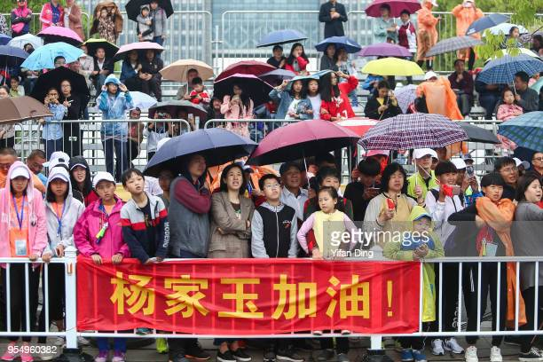Audience watch the race in the race with a banner cheering for Yang Jiayu of China during Women's 50 kilometres Race Walk of IAAF World Race Walking...
