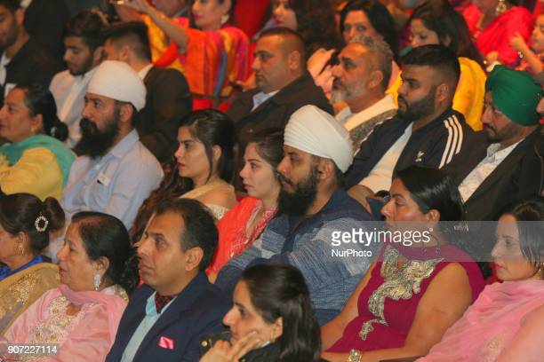 Audience watches as contestants compete in the Giddha folk dance segment during the Miss World Punjaban beauty pageant held in Mississauga Ontario...