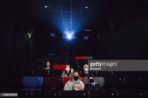 audience watching the movie in cinema after the pandemic - film industry stock pictures, royalty-free photos & images