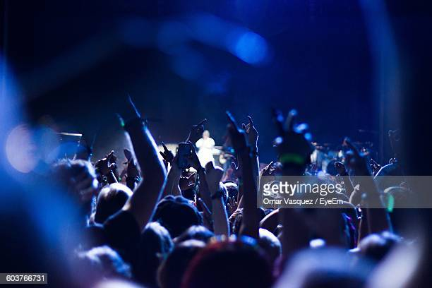 audience with arms raised at music concert - arts culture and entertainment stock pictures, royalty-free photos & images