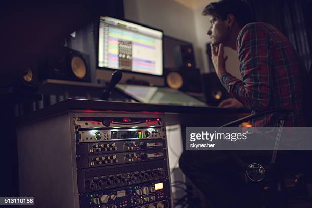 audio rack in recording studio with producer in the background. - sound recording equipment stock pictures, royalty-free photos & images