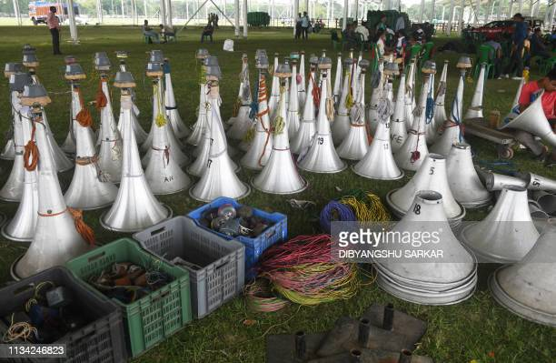 Audio speakers are pictured on the ground before Indian labourers connect the loudspeaker system for a campaign rally to be held by Prime Minister...