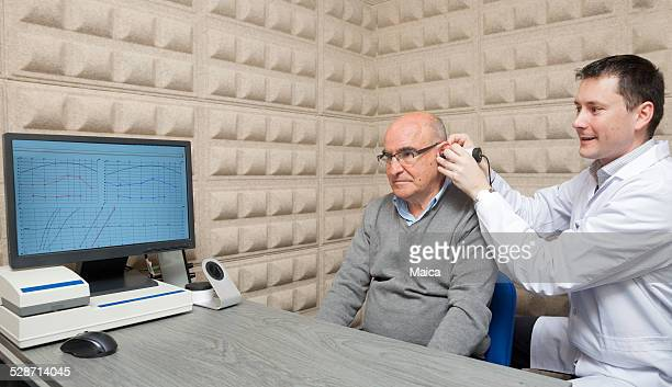 audiologist - ear exam stock photos and pictures