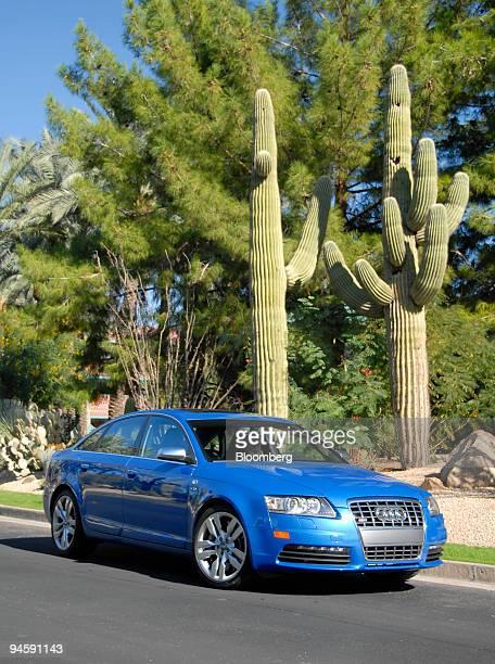 Audi's 2007 S6 Sport Sedan is seen posing near Saguaro cactus Thursday November 9 in Phoenix Arizona The sedan which is based on Audi's A6 features a...