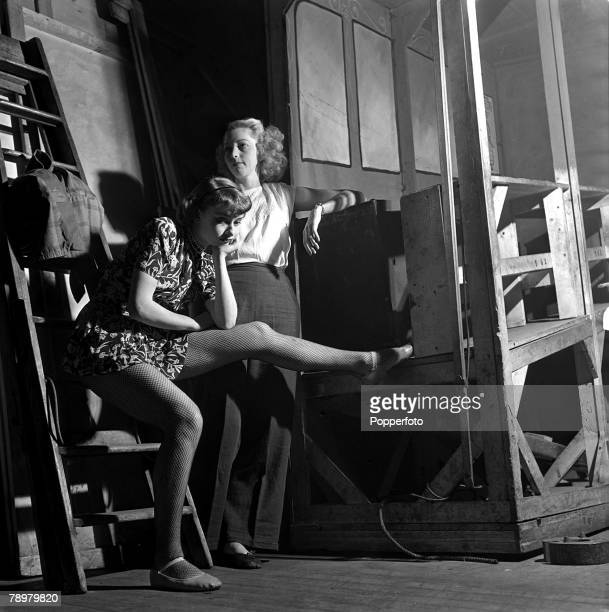 """Auditioning for a part as chorus girls, are Audrey Hepburn and Babs Johnston in a new musical by Jack Hylton called """"High Button Shoes"""""""
