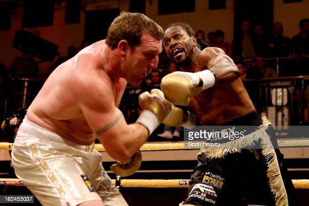 Audley Harrison in action with Martin Rogan during the International Heavywarights III betfair Prize Fighter at York Hall on February 23, 2013 in...