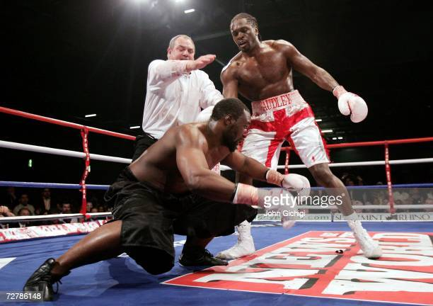 Audley Harrison lands floors Danny Williams during their Commonwealth Heavyweight fight on December 9 2006 at the ExCel Centre in London England