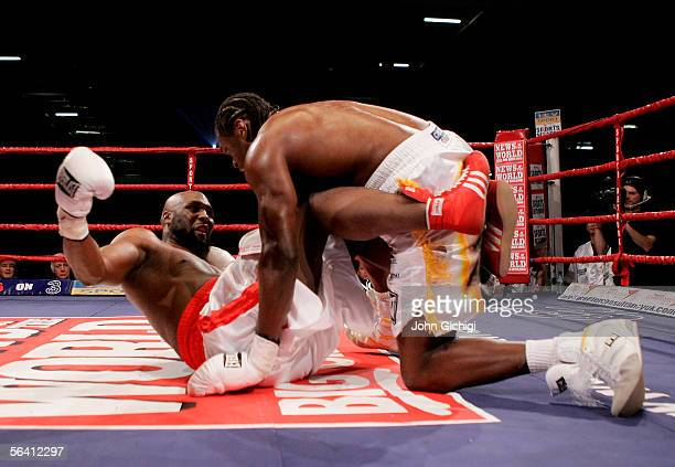 Audley Harrison of England and Danny Williams of England fall to the floor during the vacant Commonwealth Heavyweight Championship fight at the ExCel...