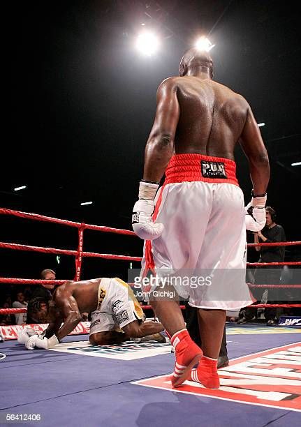 Audley Harrison of England is floored by Danny Williams of England during the vacant Commonwealth Heavyweight Championship fight at the ExCel Centre...