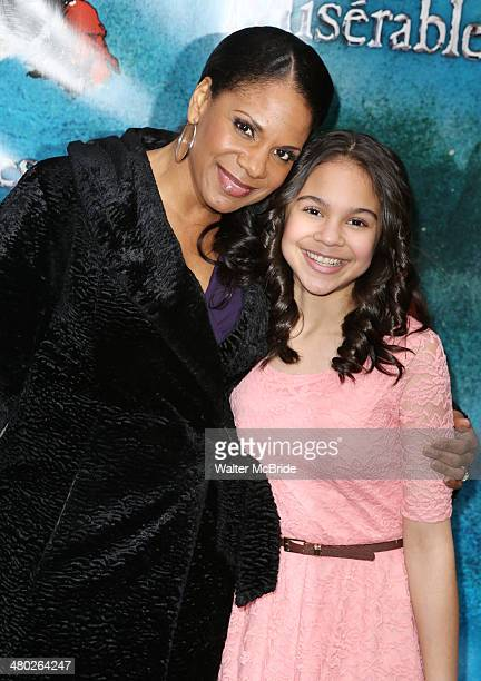Audra McDonald and daughter Zoe Donovan attend the 'Les Miserables' On Broadway Opening Night at Imperial Theatre on March 23 2014 in New York City