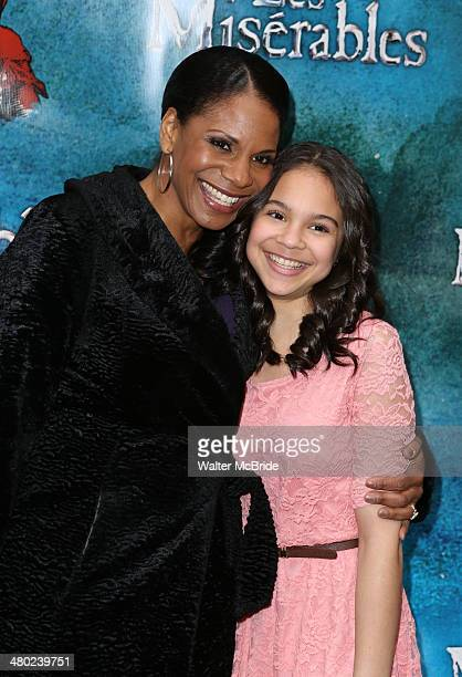 Audra McDonald and daughter Zoe Madeline Donovan attends the 'Les Miserables' On Broadway Opening Night at Imperial Theatre on March 23 2014 in New...