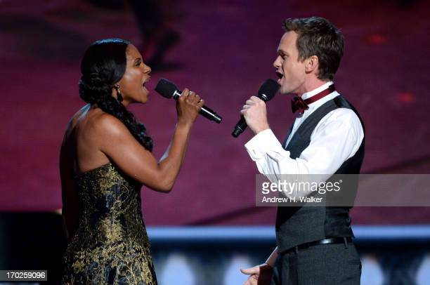 Audra McDonald and Neil Patrick Harris perform onstage at The 67th Annual Tony Awards at Radio City Music Hall on June 9, 2013 in New York City.