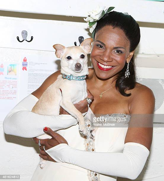 Audra McDonald and Roxie backstage at 'Lady Day At Emerson's Bar And Grill' celebrating 100 Broadway Performances at Circle in the Square on July 2...