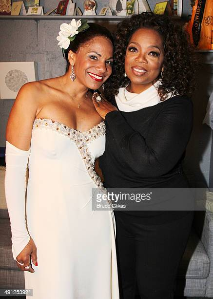 Audra McDonald as 'Billie Hollday' and Oprah Winfrey pose backstage at 'Lady Day at Emerson's Bar and Grill' on Broadway at The Circle in The Square...