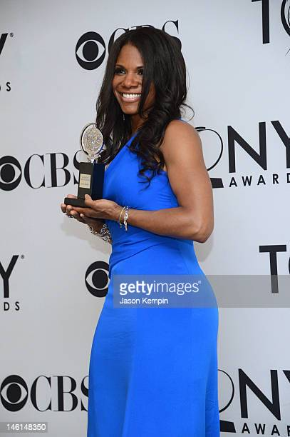 Audra McDonald Best Performance by a Leading Actress in a Musical for Porgy and Bess poses in the press room at the 66th Annual Tony Awards at The...