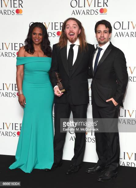 Audra McDonald Tim Minchin accepting the Best New Musical award for 'Groundhog Day' and LinManuel Miranda pose in the winners room at The Olivier...