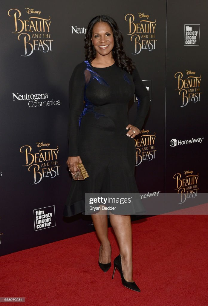 Audra McDonald who plays Madame Garderobe in Disney's Beauty and the Beast holds a Judith Leiber book bag inspired by the film at Lincoln Center on March 13, 2017 in New York City.
