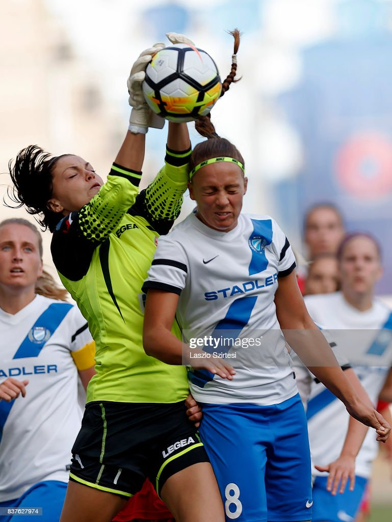 Audrey Baldwin (L) of WFC Hajvalia wins the ball in the air from Barbara Toth #8 of MTK Hungaria FC during the UEFA Women's Champions League Qualifying match between MTK Hungaria FC and WFC Hajvalia at Nandor Hidegkuti Stadium on August 22, 2017 in Budapest, Hungary.