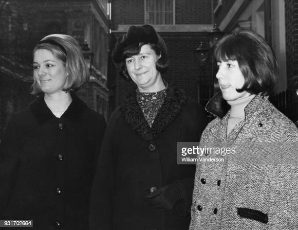 Audrey Callaghan, the wife of James Callaghan, the Chancellor of the Exchequer, leaves 11 Downing Street in London with their daughters Margaret and...