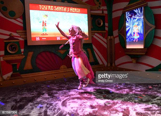 Audrey Cumberland dances underneath Santa's giant sleigh at the Santa's Flight Academy at the Cherry Creek Mall November 22 2017 Young visitors of...