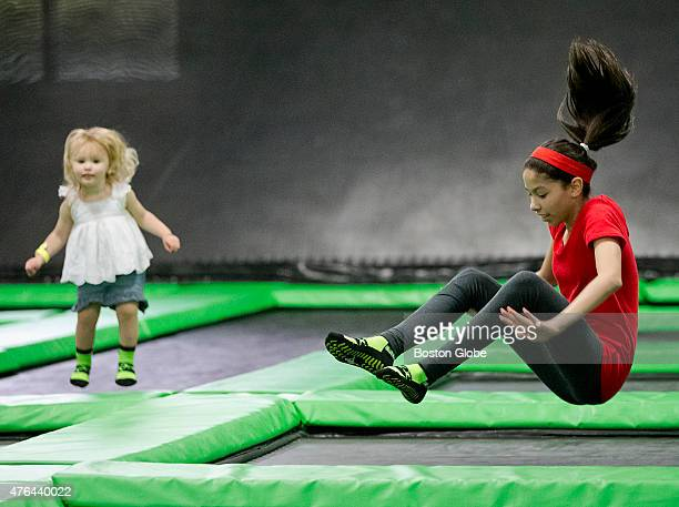 Audrey Cusano left and Briana Guzman jumping on a trampoline at Launch Trampoline Park on Friday June 5 2015