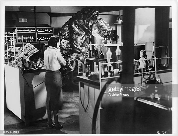 Audrey Dalton comes in contact with the monster in a scene from the film 'The Monster That Challenged The World' 1957