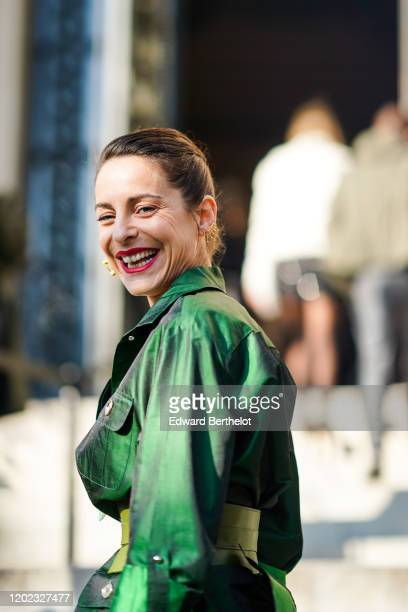Audrey Dana wears green dress earrings outside Elie Saab during Paris Fashion Week Haute Couture Spring/Summer 2020 on January 22 2020 in Paris France