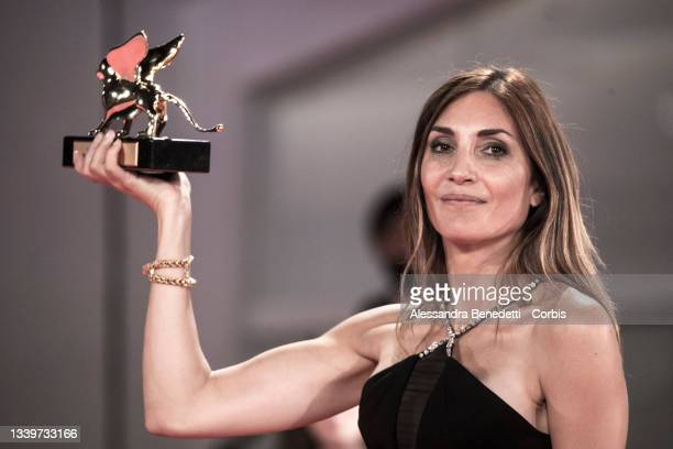 """Audrey Diwan poses with the the Golden Lion for """"L'Evenement"""" during the awards winner photocall of the 78th Venice International Film Festival on..."""