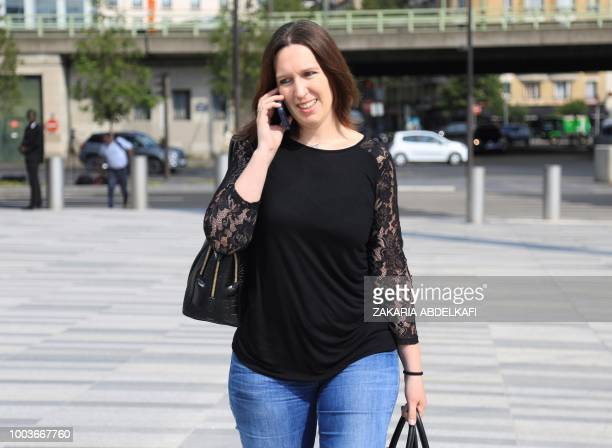 Audrey Gadot lawyer of former Elysee top security aide Alexandre Benalla speaks on her phone as she arrives at the Palais de Justice courthouse of...