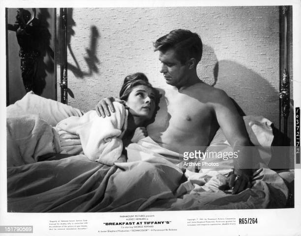 Audrey Hepburn and George Peppard in bed in a scene from the film 'Breakfast At Tiffany's' 1961